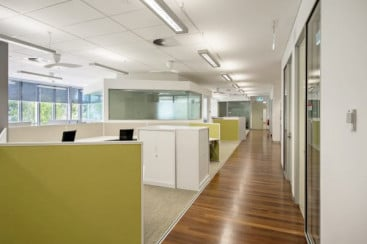 Timber flooring continues into the research work areas to form a visual connection with the public areas.