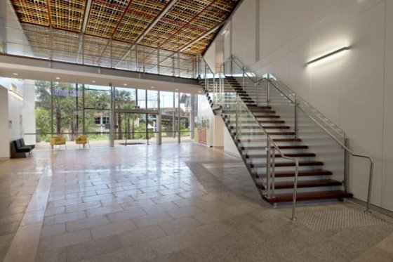 The entry foyer and exhibition space sit between research areas and teaching areas.