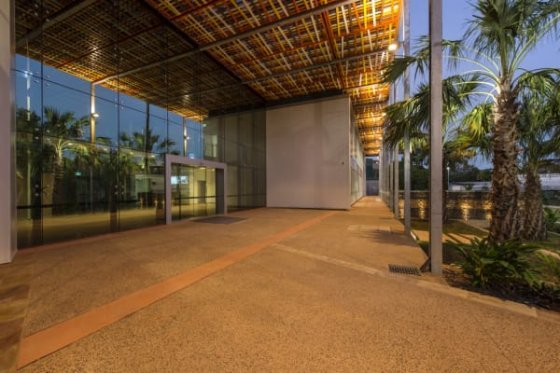 Exposed concrete floors, natural materials, textures and colours flow between inside and outside.
